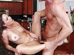 Sexy housewife Lily Love with natural tanlined tits and trimmed pussy finds herself naked and getting fucked real hard by horny delivery guy. She takes his love bone in her vagina on kitchen counter.