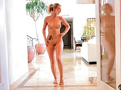 A delightful takes off her short dress. Angela poses naked for a camera with a smile on her pretty face. Her boobies and an ass look really great.