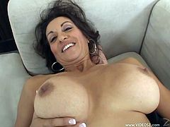 The horny mature babe Persia Monir enjoys sucking a big hard cock and gets her hairy wet pussy drilled hard on the couch.