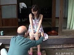 Lovely Japanese chick Asuka Hoshino is getting naughty with a man in the yard. She kneels in front of the guy and begins to suck and rub his wang.
