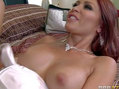 Curious redhead Monique Alexander spreads her sexy long legs and gets her pink pussy attacked by big breasted lesbian brunette Whitney Westgate. She gets strapon fucked and then dildos brunettes tight hole.