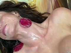 Fake tittied brunette hops on hard cock reverse cowgirl style
