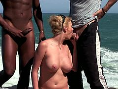 Gorgeous MILF Tarra White sucks two lucky guys on the beach and gets her perfect butthole completely rammed by a huge black cock.