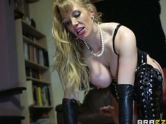 Busty blonde mom Rebecca Moore, wearing a leather outfit, is having fun with submissive guy Peter Oh Toole, wearing a mask. Rebecca humiliates Peter, then gives him a blowjob and they have anal sex.