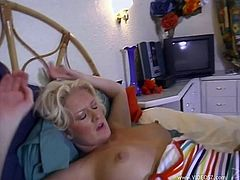 This hot cougar and her hot blonde lesbian friend lick their yummy pussies and have a little extra fun with a big hard dildo.