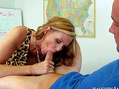Julia Ann is one on one with one of her students after class... to sucks his cock! Juicy mature lady enjoys his sausage in her mouth and then spreads her legs on a desk to let him lick her snatch.