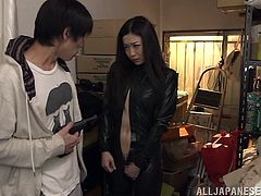 Pretty Japanese girl Ryu, wearing a leather outfit, is having fun with a guy indoors. She kneels in front of the man and sucks his dick without any emotions.