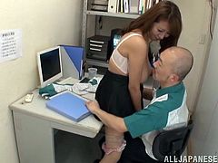 This gorgeous Japanese babe with big juicy tits gets fucked hard in office by her mature boss after giving him an amazing blowjob.
