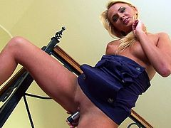 A sexy blonde girl in a negligee shows her nice booty and tits. Ivana also drills her vagina with a dildo in a close up video.
