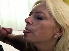 Horny granny with saggy tits and hairy pussy films in hardcore porn video. She shows her bushy pussy for camera before giving blowjob.