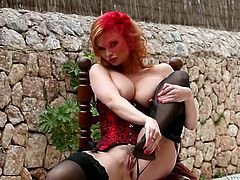 Pale skin beauty in corset and stockings Tara White teases outdoors
