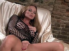 Long legged beauty Silvia Saint stokes her coochie in chair