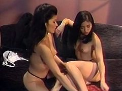 Well graced Asian babes have awesome oral sex on sofa