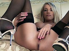 Gorgeous blonde milf Danielle Maye, wearing sexy stockings, strips and demonstrates her nice body for the cam. Then she finger-fucks her coochie and moans sweetly with pleasure.