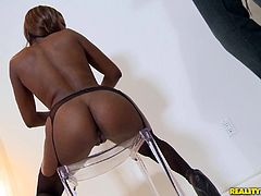 Slutty black chick Rashae, wearing stockings, shows her butt to a guy and pleases him with a blowjob. After that they bang in the reverse cowgirl and other positions.
