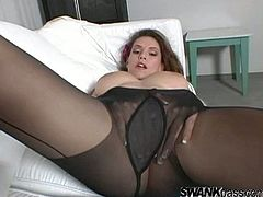 A vivacious, young brunette with long hair and big tits enjoys playing with her shaved pussy. Hear her moan with pleasure now!