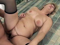 Short-haired blonde tart wearing black stockings sucks erected cock and gets her hairy quim rammed in a sideways pose. Then she rides that dick in a cowgirl pose and gets fucked mish until man fills her snapper with semen.