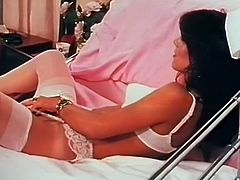 Raven haired seductive wench in white sex suit lies in bed and satisfies her incredibly hairy kitty with sex toy and fingers. Look at that steamy masturbation in The Classic Porn sex clip!