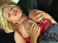 Check these cougars, with huge knockers wearing sensual lingerie, while they lick each other's pussies and play with a giant strapon.