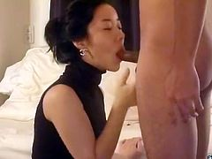 Korean escort chick in sexy dress gives blowjob in hotel