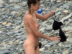Lusty voyeur must have an amazing time spying on this nude beauty while at the beach