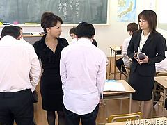 Watch these horny teacher sucking two lucky students in the middle of class as a punishment for acting up in class.
