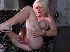 Amazingly beautiful blonde girl in a sexy lingerie shows her boobies and fingers her hot pussy. Alexis also drills her nice pussy with a dildo.
