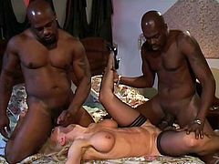 The horny MILF Nina Hartley takes a big black cock up her pussy doggystyle while she gobbles an even bigger one and gets a mouthful of cum.