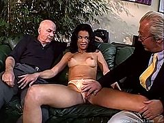 Sizzling brunette Catherine Count is having fun with a horny stud in the living room. They dude fucks all Catherine's holes and they don't pay attention to two old men watching them.