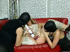 Black heads lure sexy pale blondie for sex. Spoiled lesbos with rounded butts are dressed in black dresses. They make lewd blondie stretch legs wide and stimulate her pussy with a sex toy passionately.