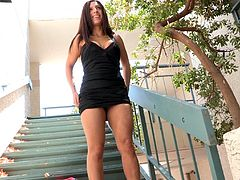 Zoey is a sexy brunette wearing a sexy black dress that'll give you a an instant boner as she pulls up her dress in public and shows off her amazing ass. Watch her masturbate with a heel in this hot solo scene.