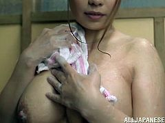 Well-endowed Japanese hottie Akiho Yoshizaw is having a good time alone. She pours water on her big boobs, then spreads her legs wide and fingers her shaved coochie.