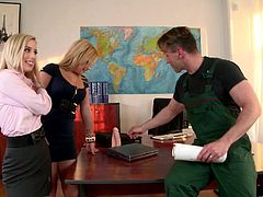 Katrin Wolf and Bibi Noel suck big dildos to seduce a workman who repairs windows in an office. These adorable babes give a double blowjob and get their mouths filled with cum.