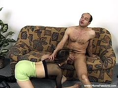 Get a boner by watching this brunette MILF, with a nice ass wearing long boots, while she gets pounded hard and moans like a wild animal.