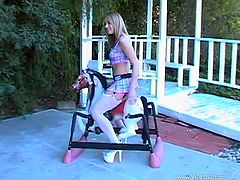 A pleasurable teen in a miniskirt and stockings poses for camera in a backyard. Maya shows off her nice ass and boobs.