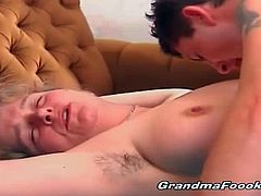 This blonde granny makes a young dude moan loud when she sucks on his dick. Next, she rides his young pecker reverse cowgirl and he gives it to her missionary.