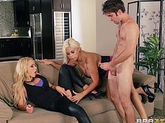 Huge-breasted blonde milfs Bridgette B and Nikki Benz are having fun with Logan Pierce indoors. They suck the dude's cock and then ride it wildly by turns.