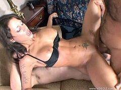 A fuckin' hot ass brunette whore with tight body and fuckin' big tits sucks on a hard cock and takes it balls deep into her gash!