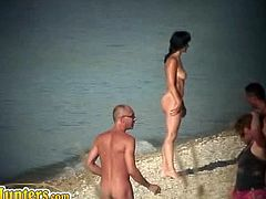 The nudist beaches are a great place for voyeurs to record people. On this beach there are many sexy chicks who walk around naked and carefree in and out of the water.