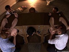 Ami Tokita and her GFs, locked in a pillory, are having fun with a few men in a hot BDSM scene. The dudes play with the chicks' snatches, then pound them with dildos.
