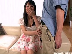Lovely Japanese girl Tsubomi kneels in front of a guy and begins to play with his dick. She takes it in her mouth and rubs it playfully. Finally, she manages to milk it dry on her hands.