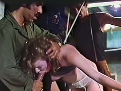 Fair haired torrid slut with big boobies and fat ass got captured by several thirsting freaks. They pounded her mouth and kitty simultaneously from both sides. Take a look at that dirty gangbang sex in The Classic Porn sex video!