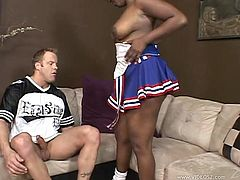 The hot chubby Kristy Amore wears her cheerleader uniform as she sucks this guy's cock and takes it up her wet black pussy.