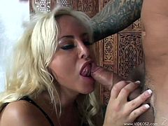 Get a load of Savannah Gold's big round breasts and her shaved pussy in this hardcore scene where you'll see this busty blonde being nailed by a big cock.