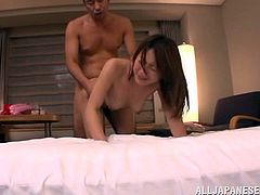 Check out this hardcore scene where this horny Asian babe wears a gagball before sucking and fucking this guy.