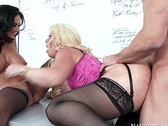 Zealous and perverted sluts Alura Jenson and Ava Addams share Johnny Castle's big cock, sucking and riding him in turns.