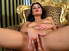 Click to watch this brunette babe, with natural boobs wearing high heels, while she touches herself sitting on a single animal print couch.