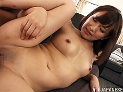 Charming Japanese milf Rino Yoshihara, wearing panties and bra, lets a man knead her big natural tits. After that they have awesome doggy style sex.