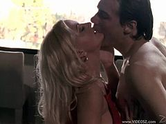 Get a load of this passionate hardcore scene where the busty blonde Stacy Valentine is fucked by a guy while wearing stockings.