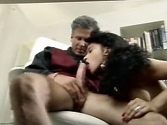 This lovely and horny brunette knows how to please her boss. She sucks his rock hard cock with great enthusiasm. Then she fucks him on top switching up positions.